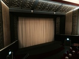 <p>Interior shot of screen curtains on re-opening night</p>