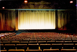 <p>The 600 seats of screen 1 seen here occupied a space large enough for over 900 conventional cinema seats of the time.  These, in fact, are from the stalls of the ABC Blackpool which were surplus to requirements following the sad tripling of that venue resulting in the cessation of live shows.</p>                            <p>The original Essoldo seats were much more comfortable and were complete with  headrests. ABC sent them back to Essoldo Furnishings in Glasgow as they were becoming ever more cost conscious and the original seats had to be maintained by Essoldo and not ABC's in house seating, carpeting and upholstery team…………</p>