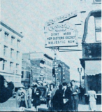 "<p>The Loew's Majestic uses the New Yorker Cocktail Bar's attraction board to promote ""Her Sister's Secret"" in 1946. The Loew's is just over manager James Carey's right shoulder on the opposite side of the street.</p>"