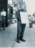 "<p>The old sandwich board on man dressed as lion bit at the Poli. Here it's 1943's""Jacare"" on the big screen.</p>"