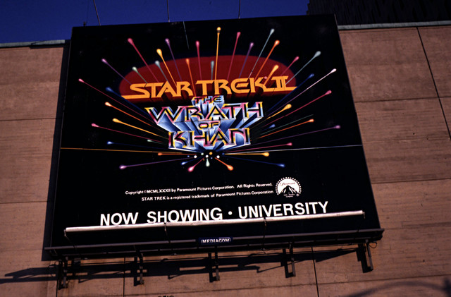 ANOTHER SHOT OF THE BILBOARD ON THE BACK OF THE UNIVERSITY THEATRE
