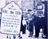 "<p>Dressed like boxing managers, Loew's Rochester staff hit the streets with boxing glove tags promoting ""Golden Boy"" in 1940.</p>"