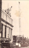 "<p>That's a brave soul doing a high ladder trick act to support the 1927 film, ""The Fire Brigade"" in front of the Loew's Temple.</p>"