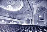 <p>Auditorium view at the Jerome's opening with sidewalls. In the center of the shot you can see one of the two Will Pogeny murals.</p>