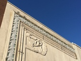 "<p>The deco relief / frieze on the north façade of the theatre is known as ""The Dancer"". It stems from days of the Paradise Theatre (1938), a reworking by architect by Thomas Kerr of the Globe Theatre (1912-1913), which became the Coronet Cinema (1965) after being reworked by architect Ross A. Lort. The ""Coronet"" sign was removed in a 1986 renovation, when the theatre became the Empire Granville 7. This façade is considered heritage, but it has no protection and could be demolished.</p>"