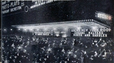 "<p>Night time shot of the Loew's New York and Roof as a big crowd awaits ""Boots and Saddles"" in 1916.</p>"
