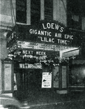 "<p>Vendome manager Bernard Thomas has a nice front with airplanes hanging from the attraction sign in 1928 for ""Lilac Time.""</p>"