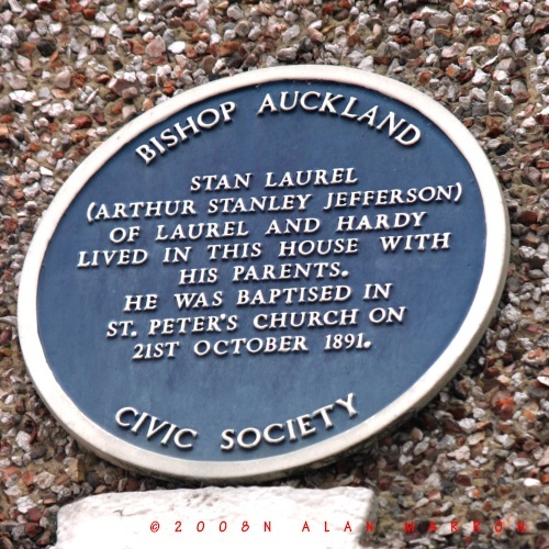 Plaque on the front of a house yards from the theatre site.