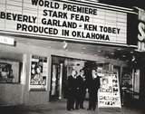 Sooner Theatre  101 E. Main Street, Norman, OK.  Three Happy Producers at the premiere in Norman Thursday night of their first motion picture, Stark Fear, (left to right) Joe E. Burke, Ned Hockman and Dwight Swain...1963.