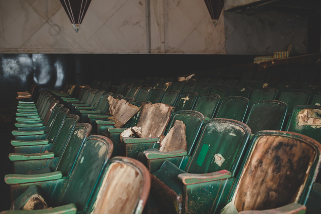 Antique green movie theatre chairs in abandoned theatre Bells, TN. Donate to revive the Bells Theatre - bit.ly/bellstheatre