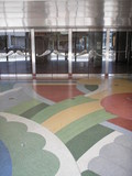 <p>Terrazzo, glass, and metal in the entrance.</p>