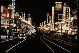 <p>Taken in 1953 (see Brigadoon on one of the other marquees), this rare color nighttime photo shows the vibrant theater row of Market Street San Francisco.  Most of the theaters shown here are now either demolished or closed.</p>