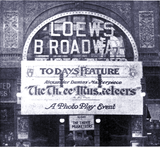 "<p>1914 shot of the Loew's Broadway Theatre with a banner for ""The Three Musketeers""</p>"