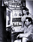 "<p>Lucky winner of the ""Them"" coloring contest gets her free TV from Utah Theatre Assistant Manager James Deveraux in 1954</p>"