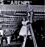 "<p>Your eyes aren't deceiving you. That is Loew's Park manager Frank Arena and he's gone to the neighboring Loew's State Theatre to put his name in light as ""Arena"" plays the State Theatre in 3D circa 1953.</p>"