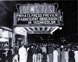 "<p>Another night exterior shot of the Loew's 72nd Street Theatre with a press screening of ""Magnificent Obsession"" in 1954</p>"