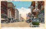 Vintage postcard showing the Majestic on the left