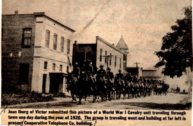 Strand Theater behind cavalry troops