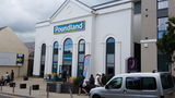 Facade of former Playhouse Cinema in Tenby - now Poundland