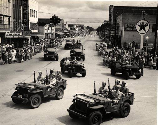 Military Jeeps parade in front of the Ritz.