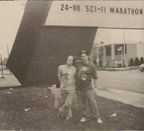 Bruce Bartoo (left), head of the horror marathon and theater owner Jeff Frank pose near the marquee.