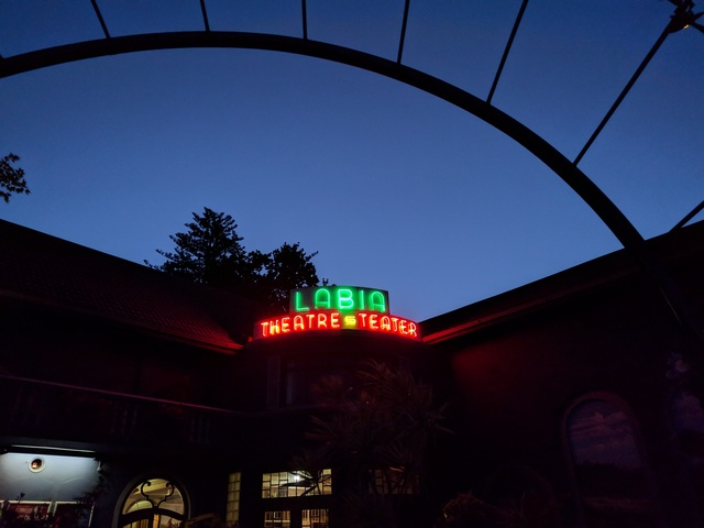 Theater exterior at dusk