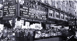<p>Loew's Poli Theatre in downtown Bridgeport stages a parade to promote its upcoming feature films in 1939</p>