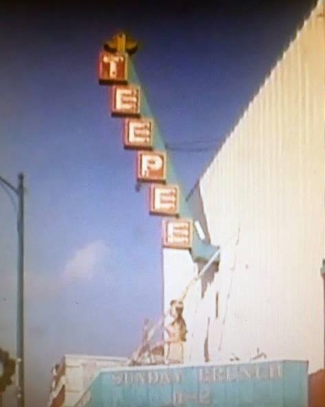Tee Pee signage with old marquee beneath.