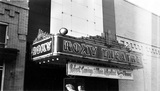 "<p>Marquee of the Roxy Theatre on Meridian Street. Very artistic banner advertising the movie ""Princess O'Rourke,"" manages to misspell both stars' names, Robert Cummings and Olivia de Havilland.</p>"