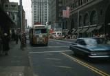 Sliver of the red Loew's Grand sign left of the bus.