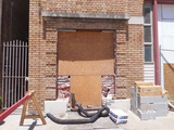 left window gone for new door, reveals brick arch for basement entry 6-16-18