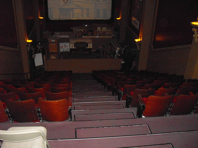 Looking down balcony towards screen