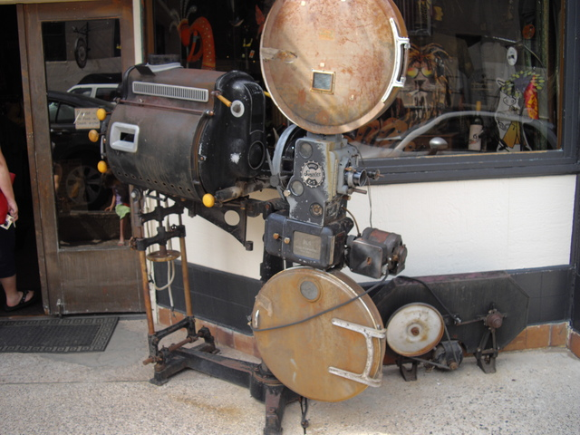 Old projector in front of theater