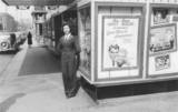 1942, Usherette Lillian Savelli in front of the Century Theatre