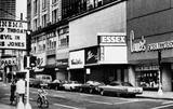 """""""Deep Throat"""" and """"The Devil In Miss Jones"""" on the State II Theatre marquee sign on the left. Circa 1973."""