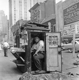 1953 photo showing the newsstand across the street from the Anco