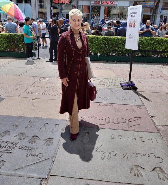 Gene Kelly's widow Patricia Ward Kelly standing in Gene's footprint, 4/14/19.