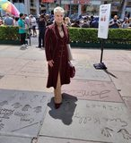 Gene Kelly's widow Patricia Ward Kelly standing in Gene's footprint, 4/14/19.