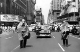 "1955, Police wearing ""radiation-resistant"" gear as they walked up Broadway. Photo credit New York Times."
