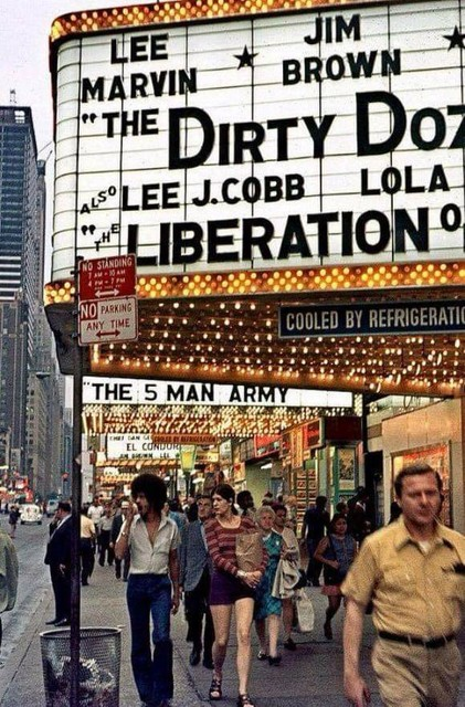 """""""The 5 Man Army"""" on the Lyric marquee behind the Victory marquee."""
