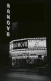 "[""1974 Ramova Theatre marquee lit at night.""]"