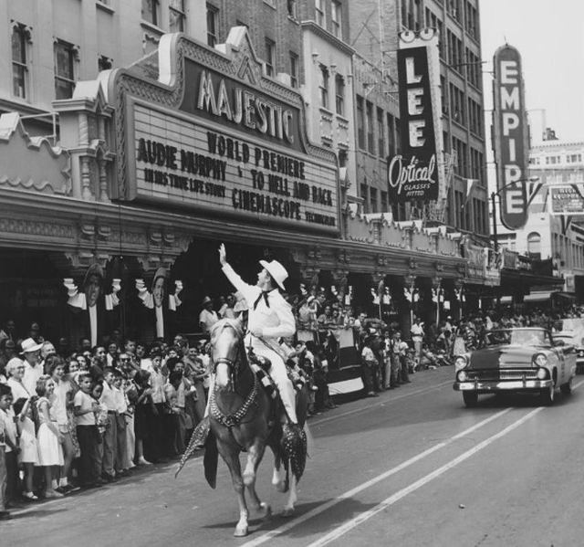 "Audie Murphy rides in front of the Majestic Theatre at the world premiere of ""To Hell and Back"" based on his life story."