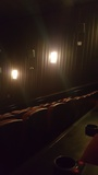 """[""""Each side of the auditorium has lights and speakers next to it""""]"""