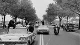 JFK motorcade passes the Boulevard Drive-In marquee, 10/28/60.