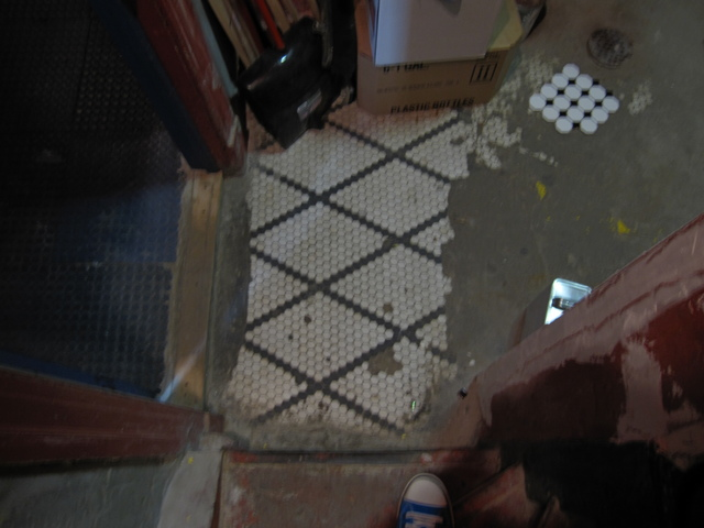 Remnant of original floor (and poor imitation)