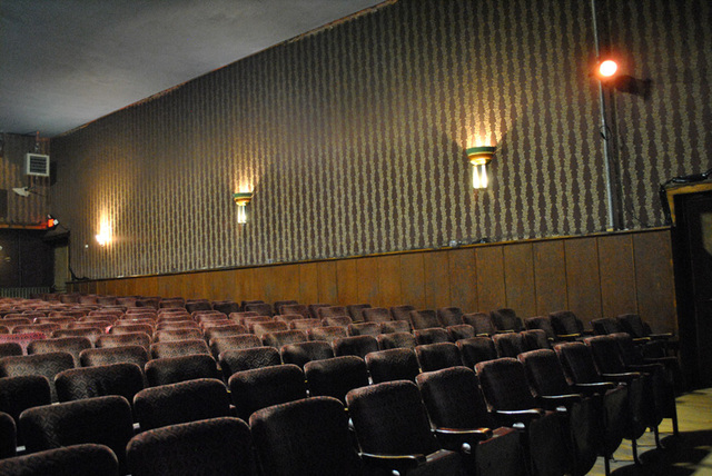 interior of theater - rows of seats and wall decor