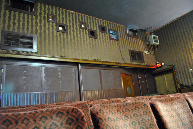 back wall of theater - showing projection portals