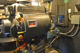booth view of 35mm projector, iron portal covers