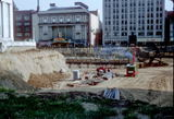 <p>Seen in background of construction of State Capitol underground garage.</p>