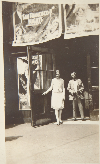 Two people at one front door of Grand Theater - 1930s
